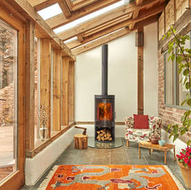 Opus Melody GLS wood burning stove with glass door and log store